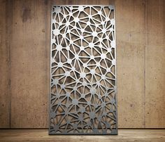 Laser cut screen Atom design www.milesandlincoln.com     Im a huge fan of laser cut screens and a panels in interiors and exteriors , this would add real interest to a room either as a a full feature wall covered in it or as panel screens dividing a space the pattern would create great light and shapes in the room!