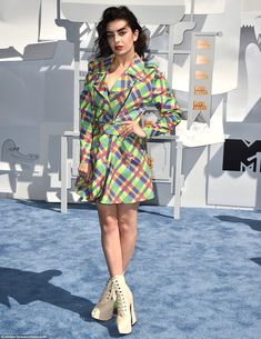 In the mood to rock: Charli XCX stepped out in platforms and a brightly coloured jacket...