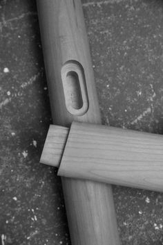 The rails that span the legs and support the saddled solid wood seat employ a double-housed mortise and tenon joint – achieving the desired simplicity without compromising strength.