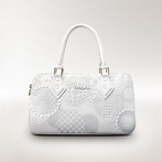 Desigual women's New Amazone White bag. It has 3 separate interior compartments. Raised print with studded detail. Handle and detachable long strap.