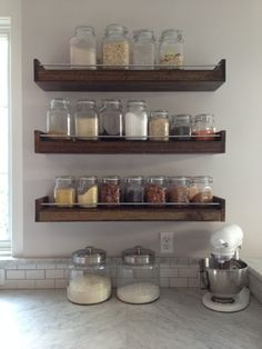 Kitchen stub wall with pretty canisters, spices, whatever, and then an empty, slightly larger shelf at the bottom for using for food prep, then trash can under. Popular items for reclaimed wood shelf on Etsy