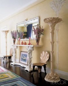 vanilla cream walls  Amy Fine Collins entrance hall with a Doug & Gene Meyer rug