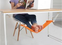 We're going crazy for this adjustable under-desk foot hammock!