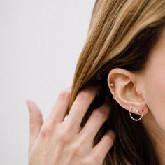 Girls That Will Make You Go For That Second, Third Or Fourth Piercing - The earring in the first and third lobe is so unique.
