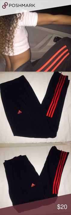 Adidas Black & Red Track Pants Adidas Black Athletic Track Pants   Size Large (Woman's)  - polyester material (feel like basketball shorts)  - Semi loose fitting. Strait legs. Stretchy waistband - Comfortable & Hipster  - Side pockets and zippers at ankles for best fit.   - Black with red racing stripes half way down the side of both legs.  - Red new adidas Logo on front upper thigh.  - Perfect New condition Adidas Pants Track Pants & Joggers