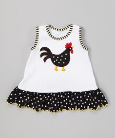 Boasting a playful print and feathered friend appliqué, this top adds fun and flair to any ensemble. Made of soft cotton with a roomy fit and darling lettuce trim, this pretty piece is playtime-approved.