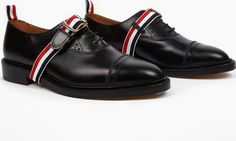 Thom Browne Black Leather Brogues The Thom Browne Leather Brogues for SS16, seen here in black. - - Demonstrating his typically offbeat aesthetic, these classic brogues from Thom Browne feature an additional buckled-strap closure in t http://www.comparestoreprices.co.uk/january-2017-6/thom-browne-black-leather-brogues.asp