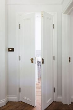 Ordinaire Locking French Doors   Bi Fold Bathroom Doors Adorned With Brass Door Knobs  Open To A Lovely Bathroom With Wood .