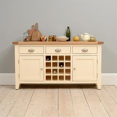 Beautiful Cheltenham Cream Sideboard with Wine Rack. Free UK Delivery on all large sideboard orders. Sideboard With Wine Rack, Kitchen Sideboard, Painted Sideboard, Kitchen Dining, Dining Room Dresser, Dining Room Furniture, Farmhouse Furniture, Wooden Furniture, Modern Chest Of Drawers