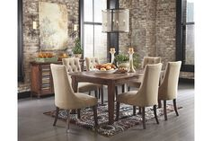 Mestler rustic dining room table with upholstered chairs and buffet serving table