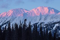 A winter sunset casts some alpenglow on the mountains in the Pine Pass. The pass lies in the rugged Hart Ranges of the Northern Rocky Mountains which form part of the Pine Le Moray Provincial Park. Dawson Creek Bc, Love Photography, Landscape Photography, Winter Sunset, Mountain Range, Texture Painting, Rocky Mountains, British Columbia, Beautiful Landscapes