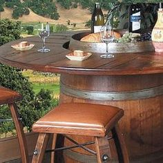 Reclaimed wine barrels made into table & bar stools! would be great for an outdoor bar!