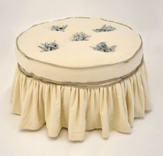 Quatrine Custom Furniture - Slipcovered Round Francis Ottoman with pom-poms and ruffle skirt. #slipcovered #ruffles #ottoman