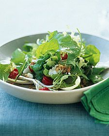 Arugula, Frisee, and Red-Leaf Salad with Strawberries  Create your own salad mix with a combination of three leafy-green varieties, each with its own unique color, texture, and flavor. In this salad, peppery, dark-green arugula contrasts with sweet, crisp red-leaf lettuce and light-green, lacy, bitter frisee. If you prefer a lighter dish, you can easily keep this salad lean and simple by omitting the walnuts and goat cheese.    More recipes for your...