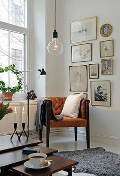 A beautiful display of collected art juxtaposed with the modern light fixture and chair. Love it! Hobbies Ideas, Home Interior, Interior Decorating, Decorating Ideas, Modern Interior, Decorating Websites, Interior Ideas, Corner Decorating, Rental Decorating