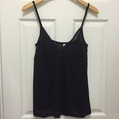 NWT H&M Slinky Black Tank Top Sexy and slinky tank from H&M. New with tags. V-neck. Button details on front opening. Has a sheer quality. Could even be used as a pajama top. 100% rayon. Size 8. H&M Tops Tank Tops