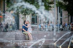 Shooting through Water Fountains Engagement Photo Idea