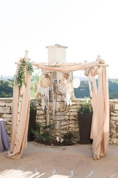Wedding huppah with dreamcatchers at One World Theatre in Austin.  Joshua Aull Photography; Altar Ego Weddings wedding planner; coordinator #mannandwife1017