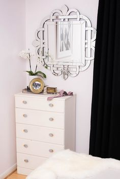 Small chic and glam master bedroom. Black and white decor  One Room Challenge - The Reveal! Chic Master Bedroom — Splendor Styling  Mirror - HomeGoods   Curtains - Bed, Bath and Beyond   Dresser - Vintage   Knobs - Anthropologie   Accessories - HomeGoods   Orchid - HomeDepot