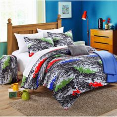 Dress up your dorm room with fun and exciting style with this Chic Home bedding kit, complete with a throw blanket. Decorated with multicolored accents on a white and grey background, this machine washable bedding will brighten any space.
