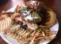 The Duke Burger at Duke's Bar and Grill in Lincoln Park costs $100 and is made of one pound of pure Kobe beef--no imitations here. As if that weren't enough, the pretzel-bun burger is topped with 6 ounces of diced lobster tail, black truffle paste and a 23-karat edible gold leaf.