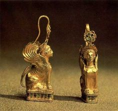 "Gold earrings in the shape of a sphinx. IV c. BC. Found in the burial mound ""Three Brothers"" at Kerch, Krym."