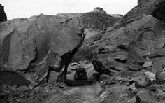 This undated photo shows a car on a road just outside of Moab. (Photo courtesy Utah State Historical Society)