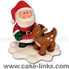 Santa stroking a Reindeer Cake Decoration