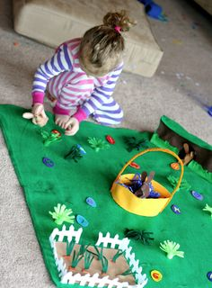 """Bunny Land"" a play mat to hide Easter eggs, have bunnies to play, and pull carrots in the garden. Very cute!"