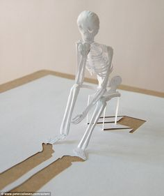Cut out skeleton made with glue and one sheet of paper by Peter Callesen.