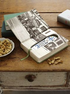 Clever Storage Using Repurposed Items :: an old book as a remote holder for the coffee table