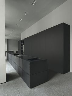 Black Minimal Kitchen Minimalism interior design doesn't always have to be white, like this beautiful minimal Minotti Cucine kitchen - Matte black island bench and black full height cupboards.