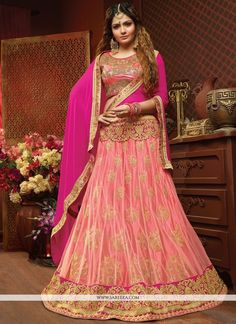 Designed with simplicity with a touch of soberness in its work makes a masterpiece. Add grace and charm to your appearance in this beautiful rose pink net lehenga choli. Beautified and stylized with a...