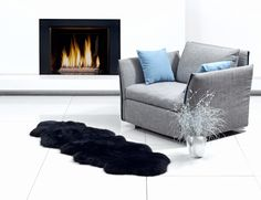 Ahhh, sitting by the fire... Beautiful black sheepskin rug by Auskin.