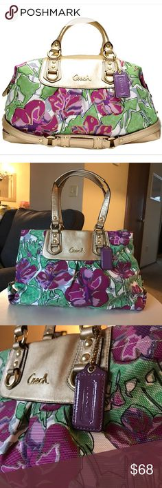 "Coach Ashley floral bag purple gold green purse This gorgeous Coach bag in Ashley floral printed textured canvas features gold leather accents and gold hardware. Purple flowers and green ""C"" logo leaves print. Perfect for spring! Some minimal spots in interior. The straps show mild crinkling from use, but in otherwise excellent condition! ""Coach"" hang tag in purple patent leather. Attachable long shoulder strap NOT included, as I never used it and it was lost in the abyss of my closet at…"