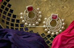 Fancy diamond earrings in gorgeous chand bali design. The 18 karat gold chand bali earrings studded with precious diamonds and a square ruby in ear stud design raj rajeswari India Jewelry, Ear Jewelry, Gold Jewelry, Fine Jewelry, Diamond Jewelry, Bridal Necklace, Wedding Jewelry, Emerald Earrings, Gold Earrings