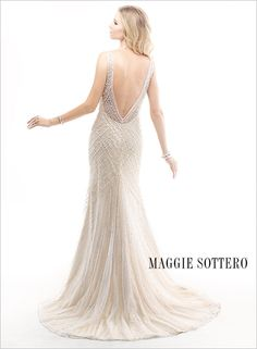 Spencer wedding dress by Maggie Sottero. The plunging V-back on this #wedding gown is beautiful!