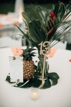 Stunning Non-Floral Wedding Centerpieces Ideas ★ non floral wedding centerpieces tropical with pineapple on big green leaf bethany small