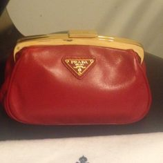Prada Coin Purse Super cute coin purse by Prada. Might be some of the softest leather I have ever touched! New, never used. Comes with authenticity cards and dust bag. Prada Bags