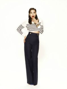 Slim figure accentuated by waist high pants and horizontal stripes. Gives it a French feel to it. The red lips completes the look.