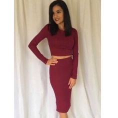 Burgundy two piece dress Beautiful long sleeve top with matching pencil skirt in a nice burgundy color two piece model is 5'4 and wearing a small size available is a medium dress is new without tags Dresses