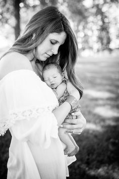 Newborn family photos, mother with newborn shot. Summer family photography.