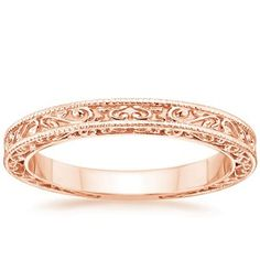 This romantic antique style band is adorned with light-catching milgrain and an engraved scroll pattern on the top and sides of the band. The perfect match to the True Heart Engagement Ring.