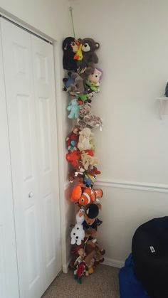 Stuffed Animal Storage.   Ribbon, key ring, clothes pin I tied knots before & after each clothes pin. Triple knotted to a key ring  heavy duty nail to hang on. I spent $2 total. (Dollar tree)  I had ribbon, key ring on hand.