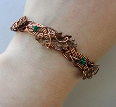 Copper Leaves Bracelet -- Braided Antique Copper Wire Bracelet With Copper Oak Leaves and Emerald Green Crystals. $46.00, via Etsy.