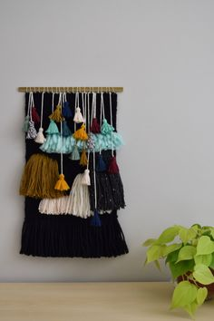Handmade Woven Wall Hanging. Abstract Tassel and Fringe Wall Art, Black and Colorful Fibers and Brass Rod, Medium Size Weaving by MeganRabilDesigns on Etsy