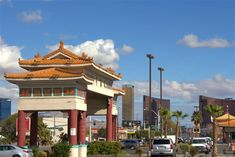 Chinatown Plaza's gate with the Las Vegas Strip in the distance © Greg Thilmont/Lonely Planet
