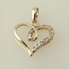 18K030-18 karat Gold plated Heart shaped pendant embedded with cubic zirconia stones  http://www.craftandjewel.com/servlet/the-799/18K030-dsh-18-karat-Gold-plated/Detail
