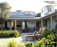 This is like my idea of a house I would love - hacienda style (only country here) with the open area in the middle.