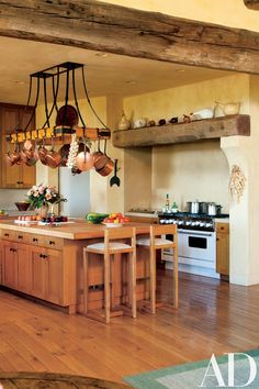 The kitchen's pot rack was designed by decorator Suzanne Tucker for the previous homeowners; ceramic hens by artist Catherine Hunter are displayed above the Viking range. Beautiful Kitchens, Cool Kitchens, Wrought Iron Decor, Tuscan Design, Tuscan Style, Tuscan Art, California Homes, California Wine, Kitchens